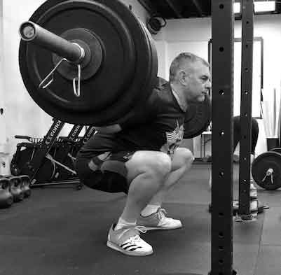 Barbell back squat at tribestrength