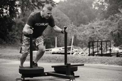 G. Horne pushing Prowler sled