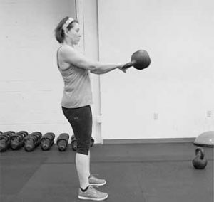 Kettlebell swing with perfect form at tribestrength.