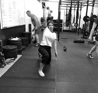 Turkish get-up with kettlebell at tribestrength.